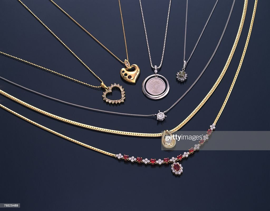 Various necklaces with jewels, high angle view, black background : Stock Photo
