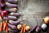 Various organic vegetables on wooden table, top view