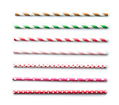 Various paper straws isolated on white background.
