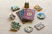 various passports and souvenir magnets from several world country ,  selective focus