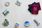 various passports and souvenir magnets from several world country