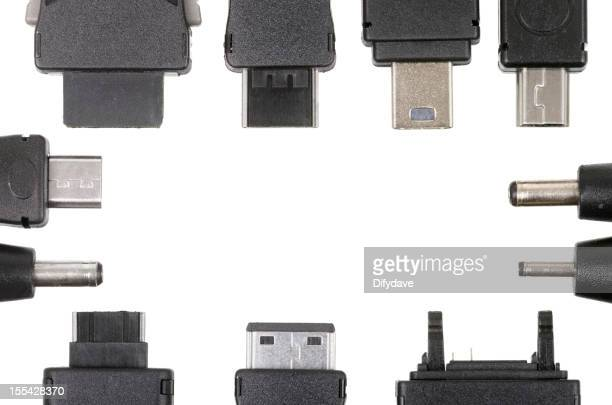 Various Plugs For Charging Mobile Phones And Other Devices