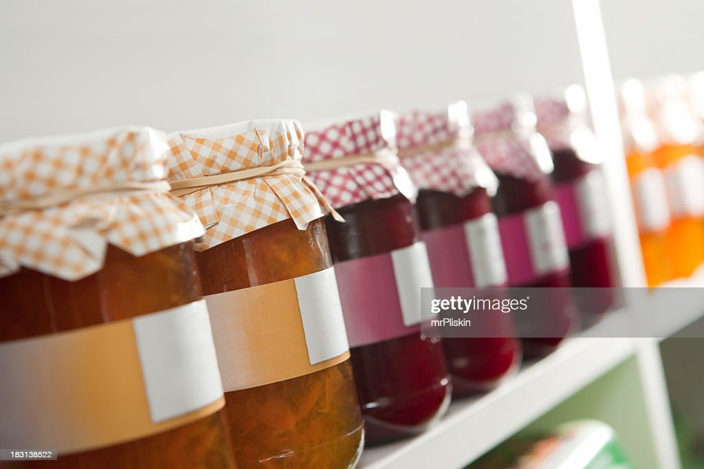 Various preserves in jars with labels