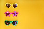 Various shapes of Sunglasses, on yellow background