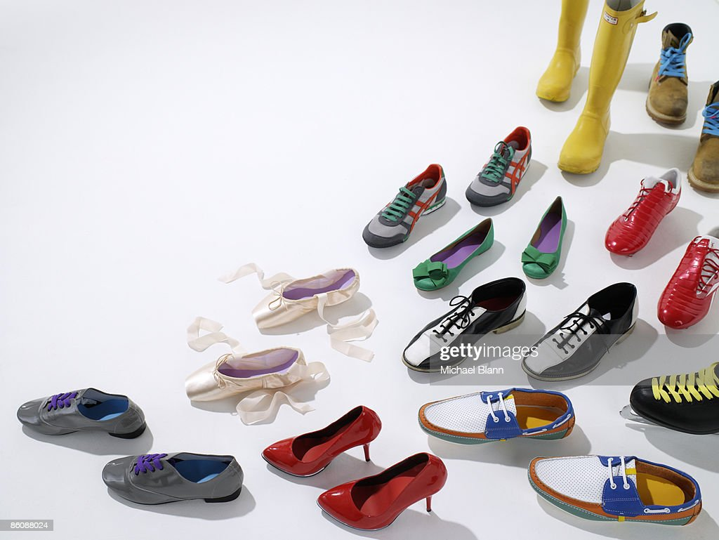 Various shoes facing one direction : Stock Photo