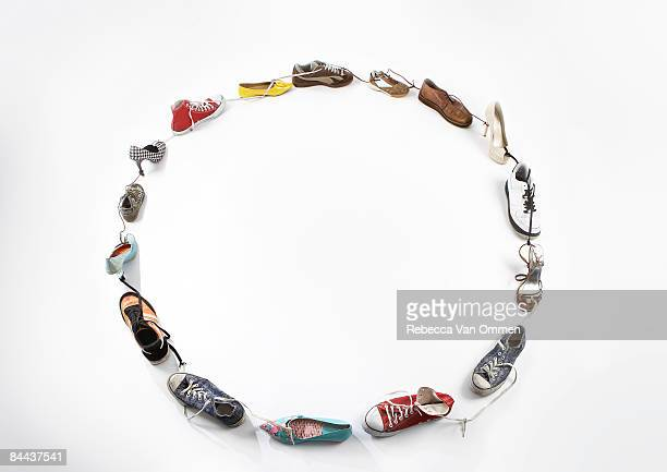 various shoe's tide together in a Circle