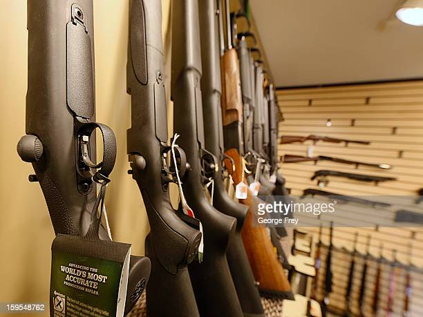 Various shotguns and rifles are on display to purchase at the 'Get Some Guns Ammo' shooting range on January 15 2013 in Salt Lake City Utah Lawmakers...