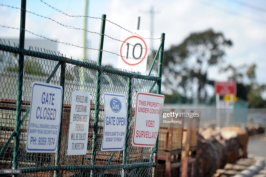 Various signs are displayed on a gate outside Ford Motor Co.'s Broadmeadows assembly plant in Melbourne, Australia, on Thursday, May 23, 2013. Ford will stop making cars in Australia, nine decades after founder Henry Ford first began building Model Ts in the country, as a surge in the currency undermines the local industry's ability to compete with imports. Photographer: Carla Gottgens/Bloomberg via Getty Images