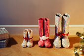various sized boots wrapped as christmas presents