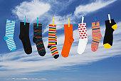 Various socks hanging on washing line