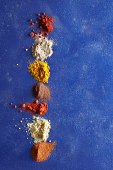 Various Spices on Blue Surface