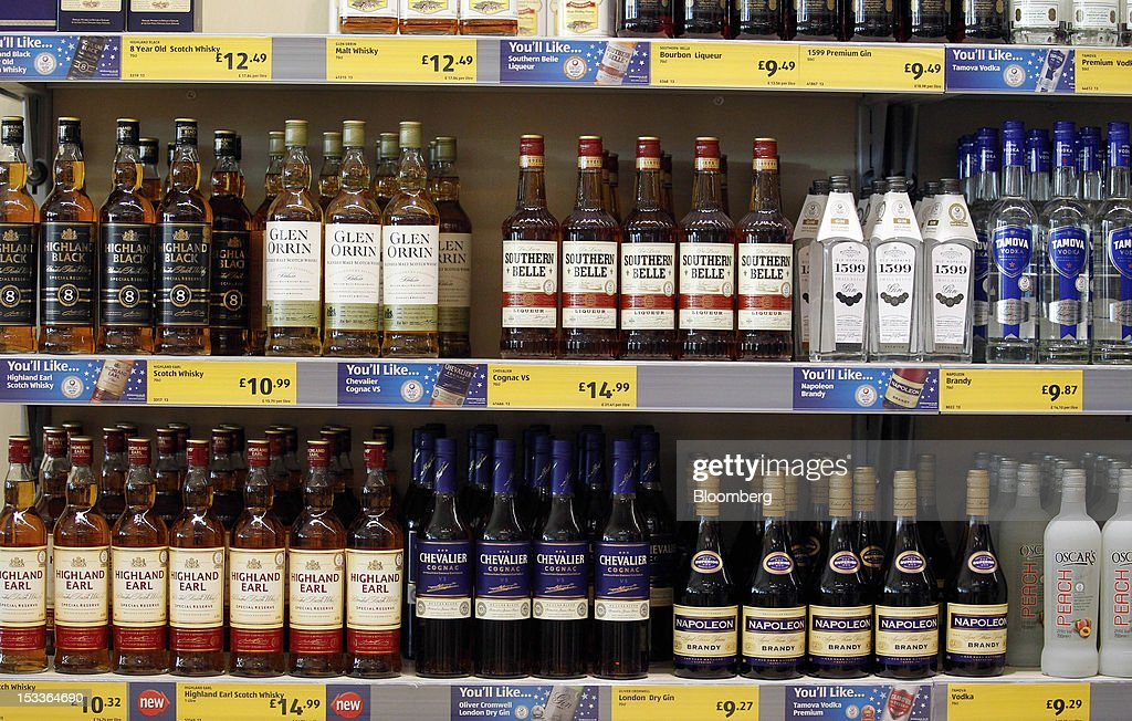 Various spirits sit on display in the ''beers, wines & spirits'' aisle at a supermarket operated by Aldi Group, Germany's biggest discount-food retailer, in Manchester, U.K., on Thursday, Oct. 4, 2012. U.K. shop-price inflation slowed in September as retailers offered discounts to attract cash-strapped consumers, the British Retail Consortium said. Photographer: Paul Thomas/Bloomberg via Getty Images