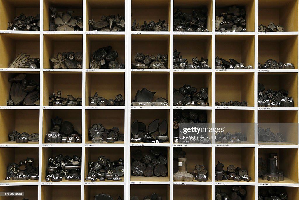 Various steel shapes, used to make artificial flowers, are stored on shelves on June 17, 2013 at the Maison Lemarie, in Paris. Founded in 1880 and purchased by Chanel in 1996, Lemarie is one of the last artisanal house remaining in France which is specialized in feathers and flowers for haute couture. AFP PHOTO / FRANCOIS GUILLOT