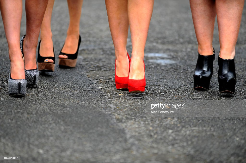 Various styles of foot wear worn by racegoers on Ladies Day at Punchestown racecourse on April 26, 2013 in Naas, Ireland.