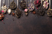 Various tea in spoons. Black, green and red tea. Top view with space for your text