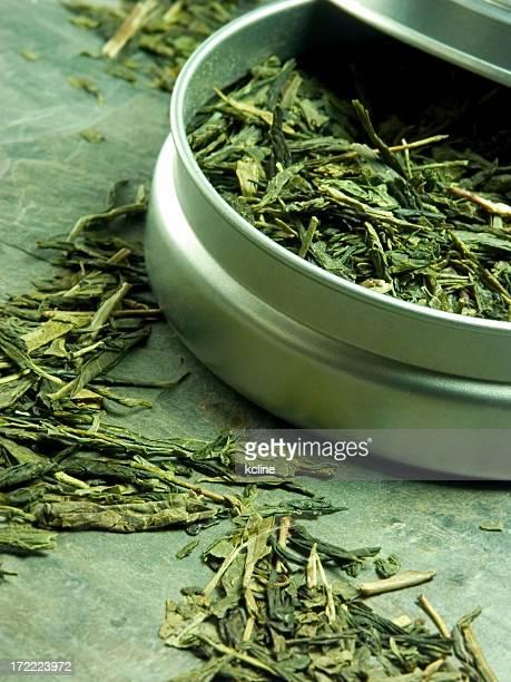 Various tea leaves being ground up