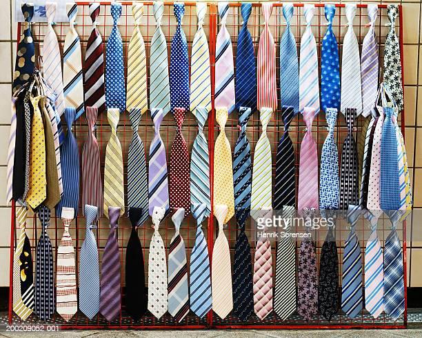 Various ties displayed on rack