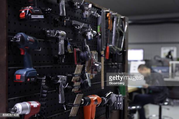 Various tools are stored on a wall in a workshop at the DMMmake Akiba hardware incubation space operated by DMMcom Ltd in Tokyo Japan on Tuesday July...