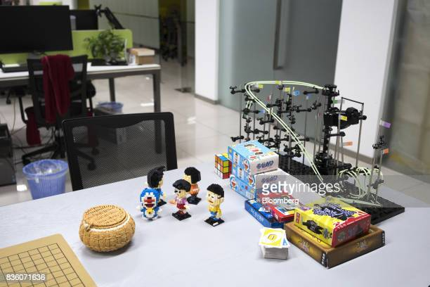 Various toys and card games sit on a table at the Sinovation Ventures headquarters in Beijing China on Tuesday Aug 15 2017 Sinovation Ventures'...