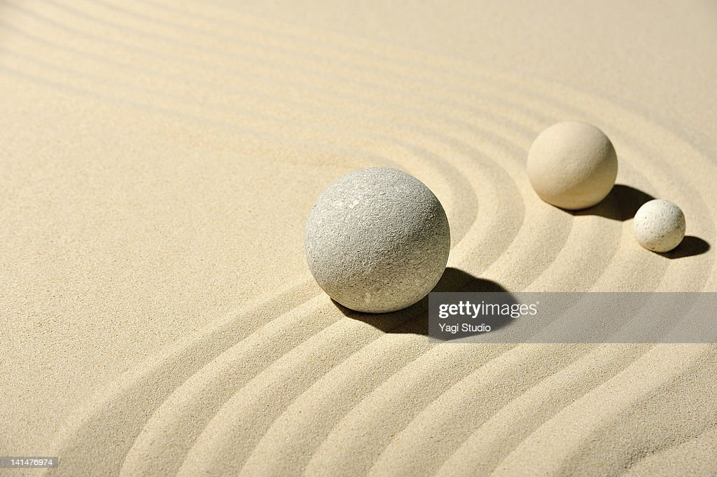 Various types of ball and wave pattern in the sand : Stock Photo