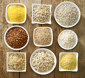 various kinds of cereal grains on old wooden table