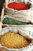 Various types of colorful lentils at a market