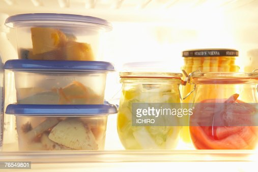 Various types of food in plastic container pots in refrigerator