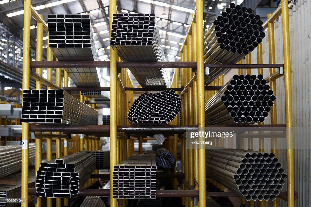 Various types of steel tubing sits stacked on shelves in the tube mill at the manufacturing facility of Uttam Galva Steels Ltd the Indian unit of...
