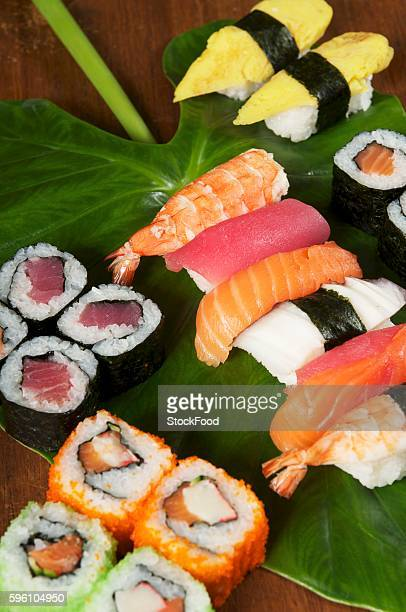 Various types of sushi on a leaf