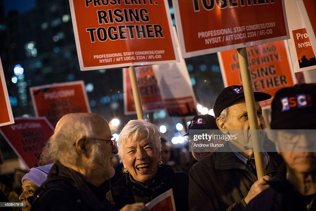 Various unions, social causes and organizations attend a rally calling on greater social equality, organized by non-unionized fast food workers demanding for a wage raise from $7.25 per hour to $15.00 per hour and to be unionized on December 5, 2013 in New York, United States. The day held various protests in front of fast food outlets around the country and culminated in a larger rally attended by various groups in downtown Manhattan.