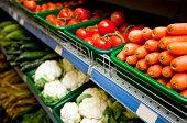 Various vegetables on display in grocery store