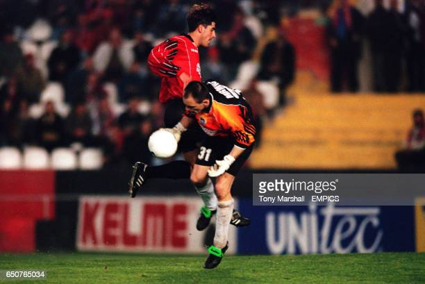 Varteks Varazdin goalkeeper Maridan Mrnic collects the ball under pressure from Real Mallorca's Veljko Paunovic