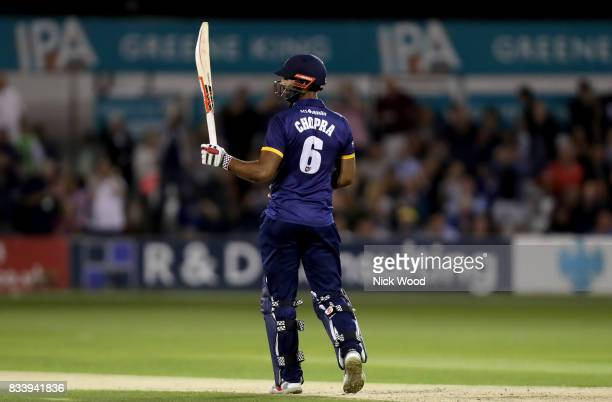 Varun Chopra of Essex celebrates scoring fifty runs during the Essex v Kent NatWest T20 Blast cricket match at the Cloudfm County Ground on August 17...