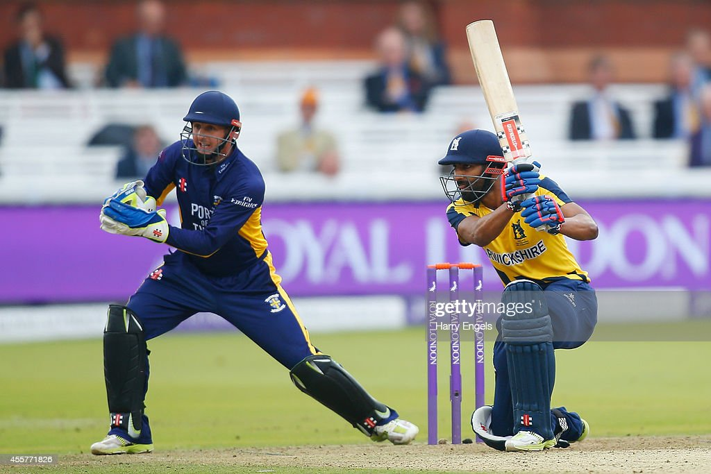Varun Chopra of Warwickshire hits out watched by Durham wicketkeeper Phil Mustard during the Royal London OneDay Cup Final between Warwickshire and...