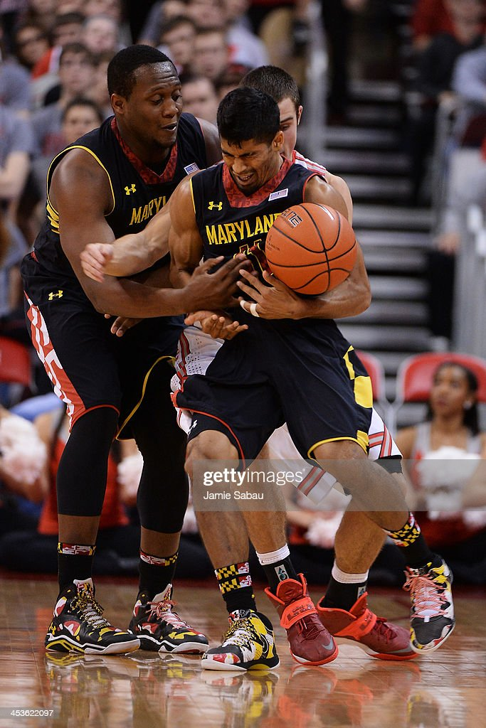 Varun Ram #11 of the Maryland Terrapins is fouled by <a gi-track='captionPersonalityLinkClicked' href=/galleries/search?phrase=Aaron+Craft&family=editorial&specificpeople=7348782 ng-click='$event.stopPropagation()'>Aaron Craft</a> #4 of the Ohio State Buckeyes in the second half as Charles Mitchell #0 of the Maryland Terrapins moves in to help on December 4, 2013 at Value City Arena in Columbus, Ohio. Ohio State defeated Maryland 76-60.