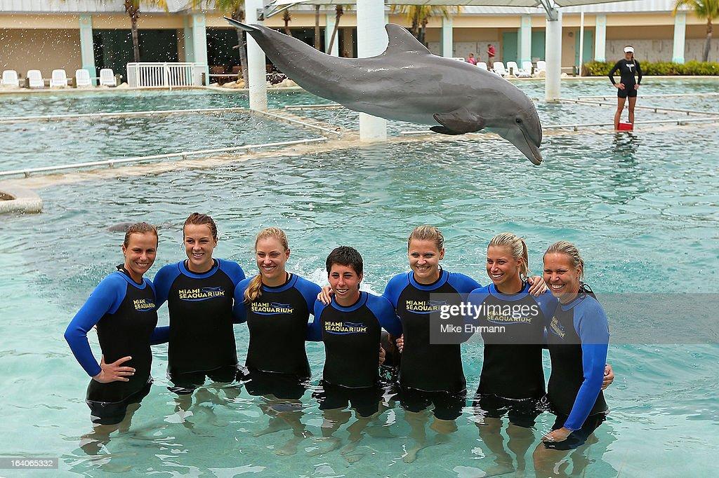 Varvara Lepchenko Anastasia Pavlyuchenkova Angelique Kerber Carla Suarez Navarro Lucie Safarova and Lucie Hradecka pose with the dolphins at the...
