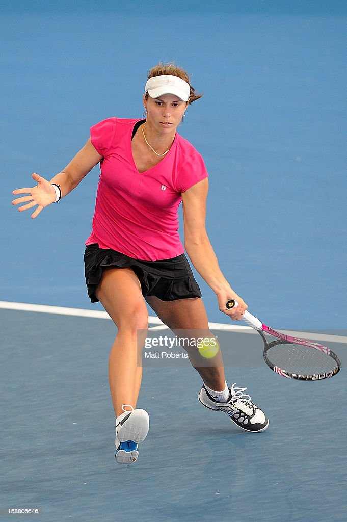 Varvara Lepchenko of the United States plays a forehand in her match against Serena Williams of the United States during day one of the Brisbane International at Pat Rafter Arena on December 30, 2012 in Brisbane, Australia.