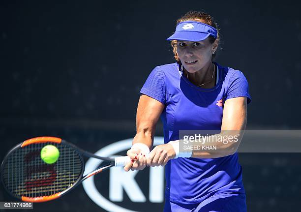 CORRECTION Varvara Lepchenko of the US hits a return against Kiki Bertens of the Netherlands during their women's singles first round match on day...