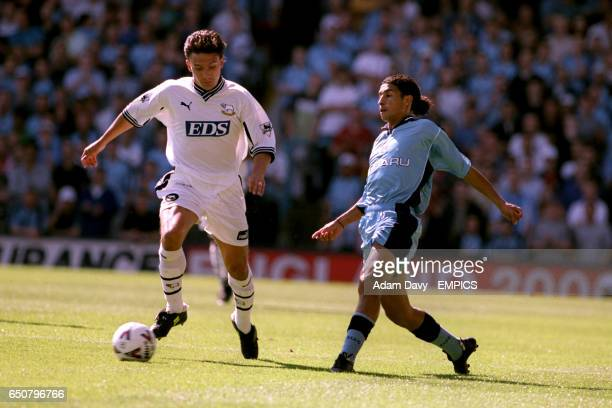 LR Vas Borbokis Derby County gets away from Coventry City's Youssef Chippo
