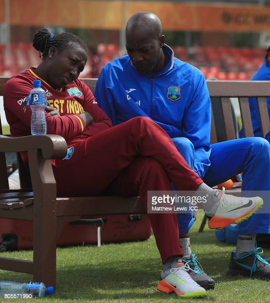 Vasbert Drakes Coach of West Indies talks to Stafanie Taylor captain of the West Indies after their first innings during the ICC Women's World Cup...
