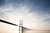Vasco Da Gama Bridge against dramatic sky, Tagus River, Lisbon, Portugal