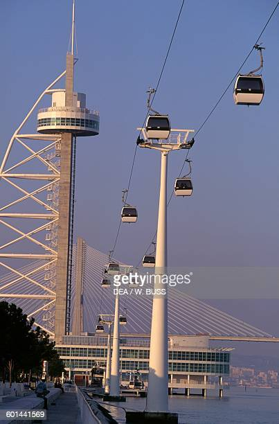 Vasco da Gama tower and the cable cars in the area around the Park of Nations with the Vasco da Gama bridge in the background created for Expo 1998...