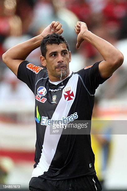 Vasco Da Gama's Diego Souza celebrates after scoring against Flamengo during the Brazilian Championship final date match on December 04 2011 in Rio...