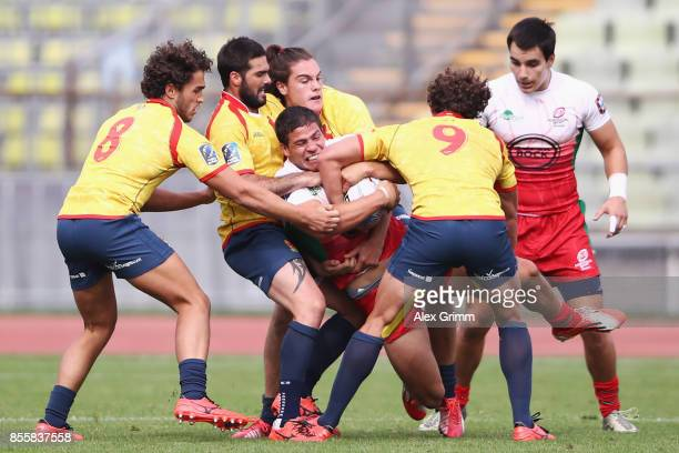 Vasco Mendes of Portugal is tackled by Jacobo Martin and Manuel SainzTrapaga of Spain during the match between Portugal and Spain on Day 2 of the...
