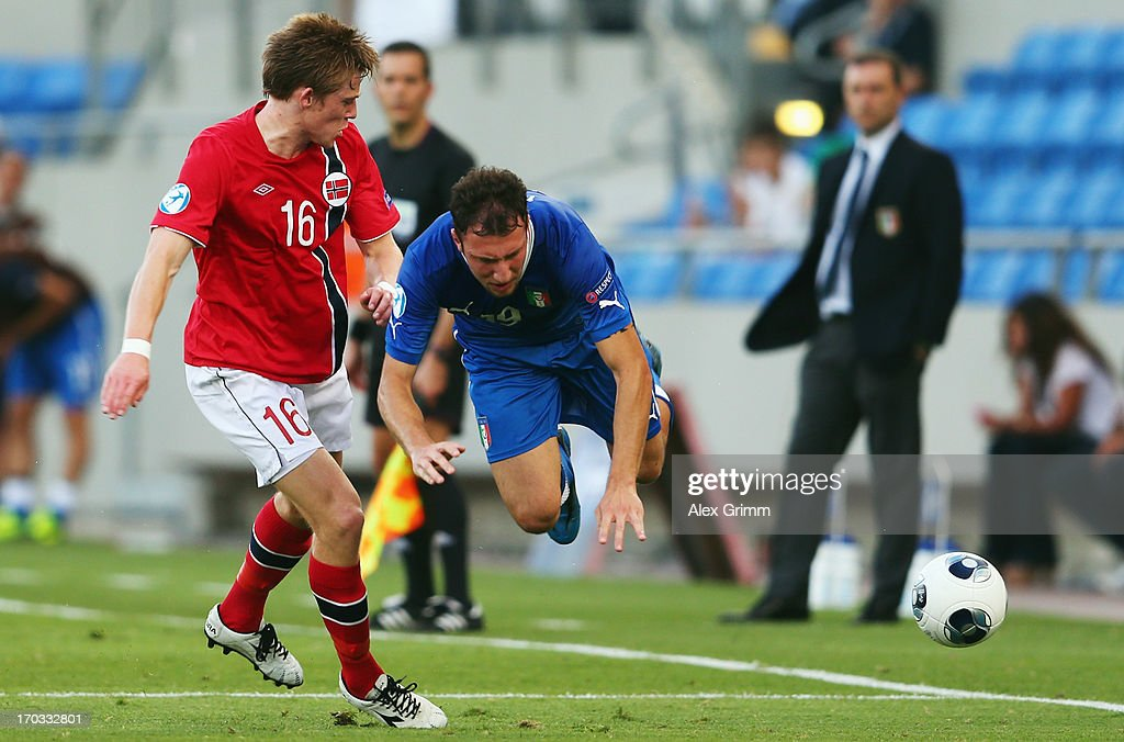 Vasco Regini (R) of Italy is challenged by Yann-Erik de Lanlay of Norway during the UEFA European U21 Championship Group A match between Norway and Italy at Bloomfield Stadium on June 11, 2013 in Tel Aviv, Israel.