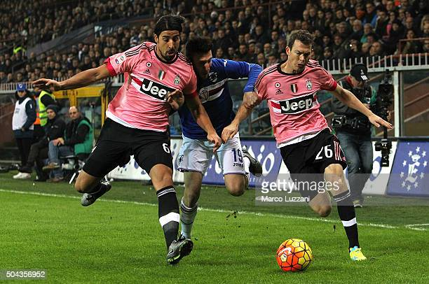 Vasco Regini of UC Sampdoria competes for the ball with Sami Khedira and Stephan Lichtsteiner of Juventus FC during the Serie A match between UC...