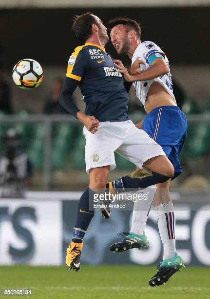 Vasco Regini of UC Sampdoria jumps for the ball with Giampaolo Pazzini of Hellas Verona during the Serie A match between Hellas Verona FC and UC...