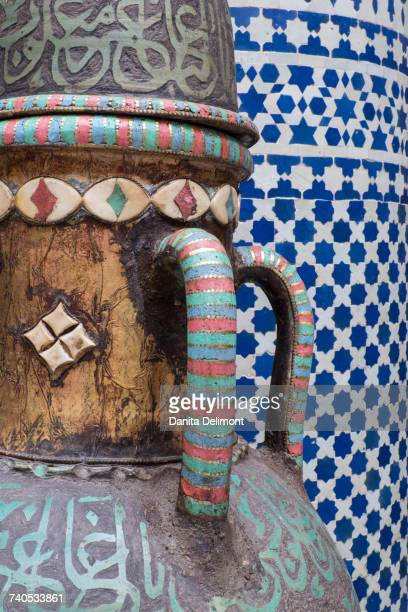Vase and pillar details with traditional design in interior of riad, Fez, Morocco