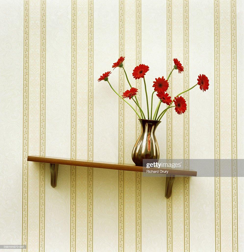 Vase of gerberas on crooked shelf (digital enhancement)