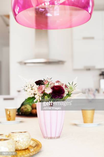 Vase with flowers on dining table